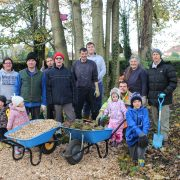A group volunteers stand in the Centenary Garden at Boultham Park.